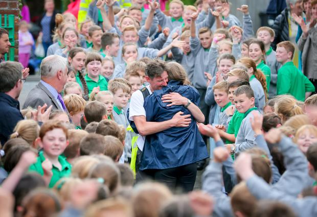 Dermot Breen and his daughter Hannah as he arrives at Greenisland Primary School after his 1,000km walk for his wife Jacqui Breen