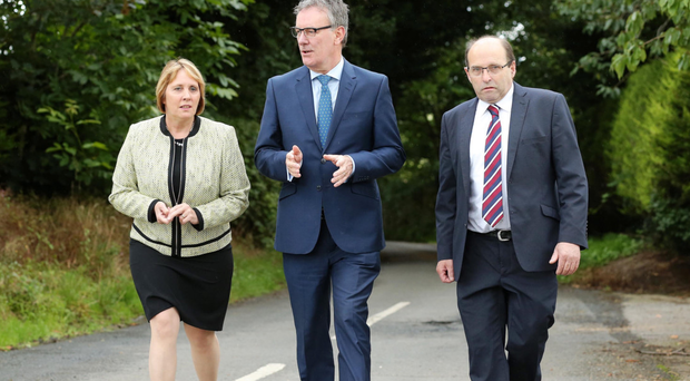 Ulster Unionist Party leader Mike Nesbitt (centre) with new party members John and Jenny Palmer, formerly with the DUP