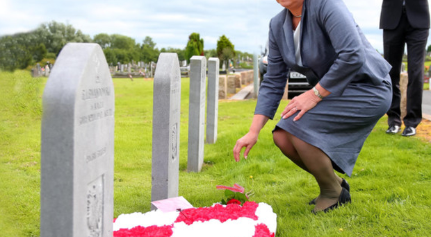 Member of the European Parliament for Poland, Anna Fotyga, lays a wreath at one of the graves of Polish airmen at Milltown Cemetery in Belfast