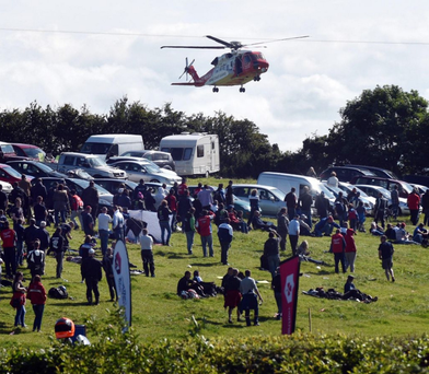 An air ambulance lands at Armoy last month to transfer an injured racer to hospital in Belfast