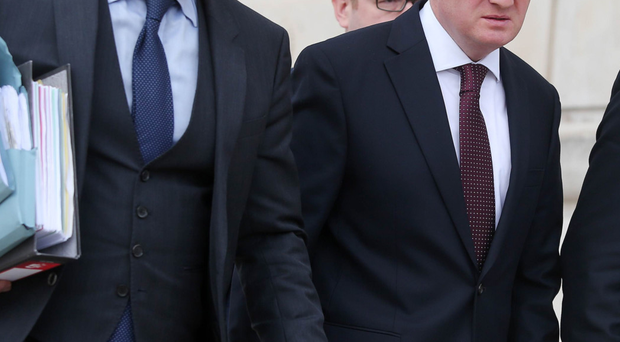 Businessman Gareth Graham (right) leaves Stormont yesterday after giving evidence at the Nama inquiry