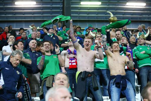 Northern Ireland fans celebrate the European Championship qualifying victory over the Faroe Islands last night