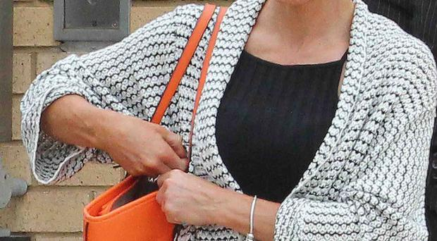 Maureen Curoe leaves the county court in Antrim yesterday