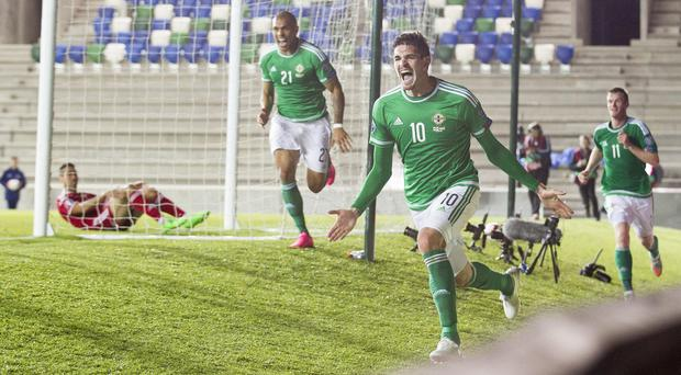 Kyle Lafferty celebrates scoring during the European Championship qualifying match at Windsor Park, Belfast