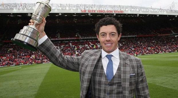 Rory McIlroy parades his Claret Jug at Old Trafford last year