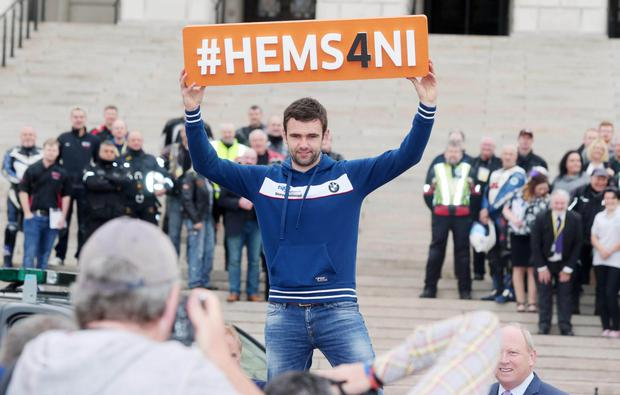 Motorcycle racer William Dunlop at Stormont where a petition calling for an air ambulance for Northern Ireland was handed over