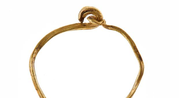 A gold ring dating from at least the 12th century which has been discovered during road building work in Co Fermanagh (Department of the Environment/PA)