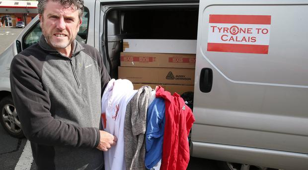 John Hurson with some of his cargo destined for refugee camps