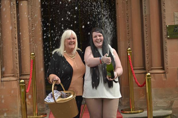 Cleaner Maureen Wilkinson celebrates with her daughter Kimberley McCaughey at the Culloden Hotel yesterday after winning £300,000 on a scratchcard