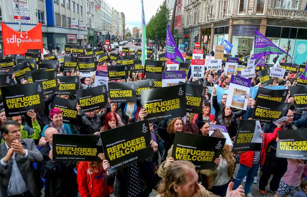 Supporters at a rally in Belfast city centre illustrating their support for inviting refugees into Northern Ireland