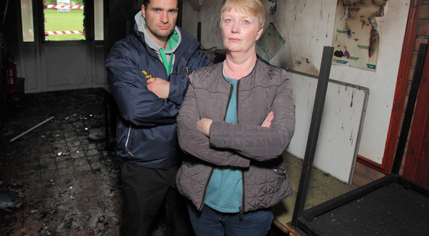 Player Ryan O'Neill and secretary Mary Daly examine the damage to the GAA club in Moy