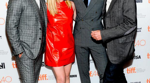 Actors Luke Evans, Eiisabeth Moss, Tom Hiddleston and Jeremy Irons share a joke at the premiere for High-Rise at the Elgin Theatre during the Toronto International Film Festival