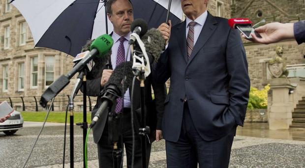 Peter Robinson and Nigel Dodds speak to the media at Belfast Castle