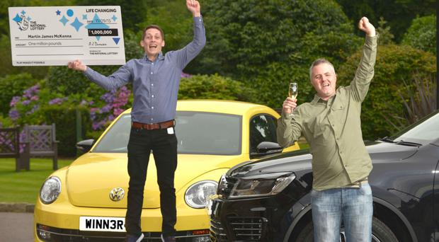 Martin McKenna (right) celebrates with his friend Gerard after scooping the £1m prize