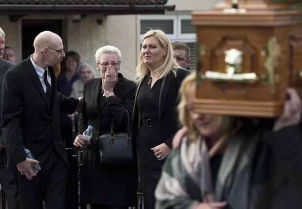 Grief stricken: family and friends of Disappeared victim Seamus Wright attend his funeral at St Agnes' Church in west Belfast