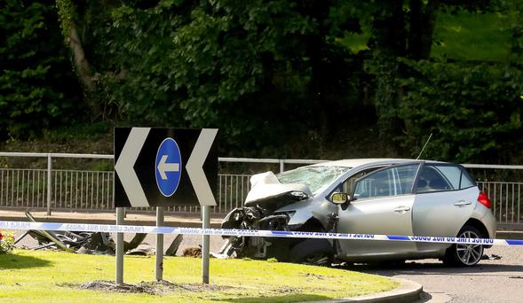 Police at the scene of the fatal road crash in Dunmurry yesterday