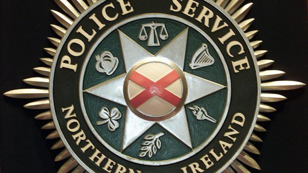 PSNI officers searched a house in the Hillsborough Road area of Lisburn