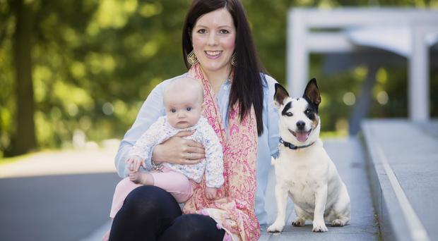 Healthy smiles: Jayne Bailie and baby Evie with Floyd