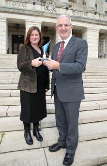 Danny Kennedy MLA receives a 'Cycling Champion' award from Belfast Telegraph Environment Correspondent Linda Stewart after he missed out on a Cycling Planning Award when he resigned his ministerial post at Stormont last week