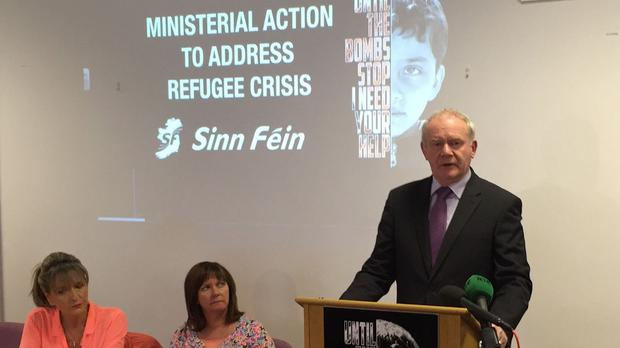Martin McGuinness speaking at a refugee crisis event in Parliament Buildings, Stormont, Belfast