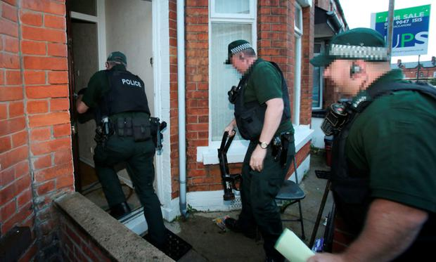 PSNI officers carry out a drugs raid on a house in east Belfast as part of Operation Torus