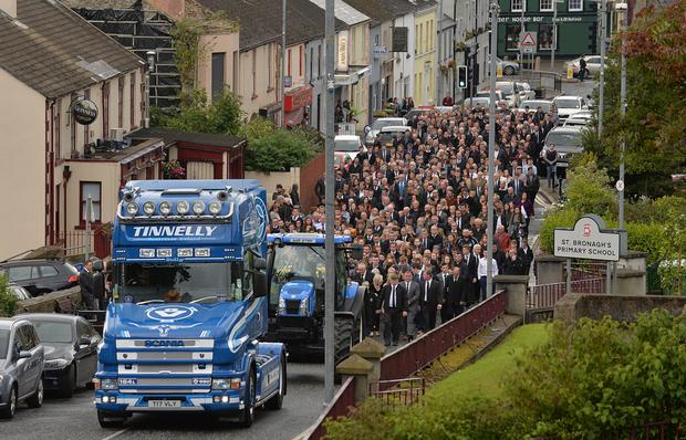 A lorry and tractor led the cortege at the funeral of Eoin Farrell yesterday at St Mary's Church in Rostrevor, Co Down