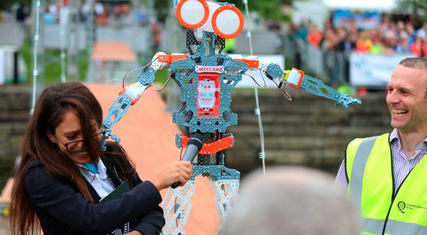 Guinness adjudicator Fortuna Burke is struck on the head by by Meccano's new Meccanoid GS15 KS Robot
