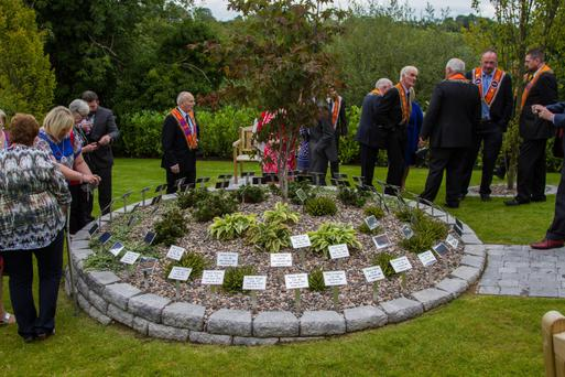 Relatives of the deceased are among those in attendance at Saturday's dedication service of the garden of remembrance, which was built in tribute to 68 murdered Orangemen