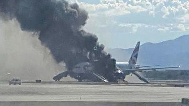 The Boeing 777-200 burning on the ground at Las Vegas (handout photo taken with permission from the Twitter feed of Eric Hays, @ericmhays )