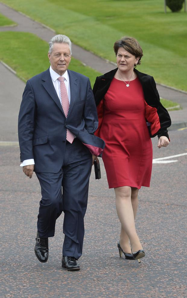DUP leader Peter Robinson with Arlene Foster at Stormont yesterday