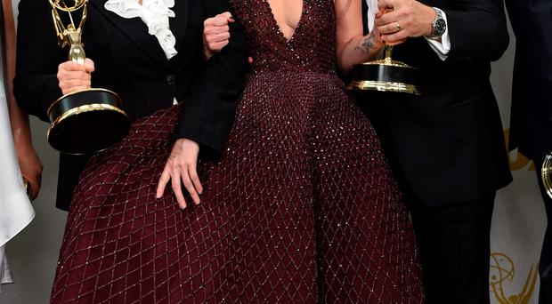 Game of Thrones star Lena Headey celebrates the series' triumph at the Emmys with production crew members
