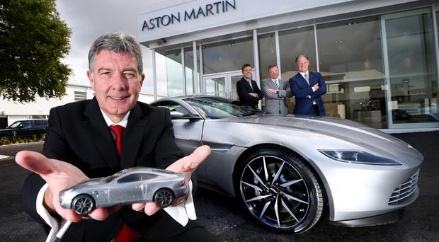Colin McNab of Charles Hurst at the launch of the new Aston Martin showroom with Marcus Blake (Aston Martin), Richard Gould (Charles Hurst) and Andy Bruce (Lookers plc)