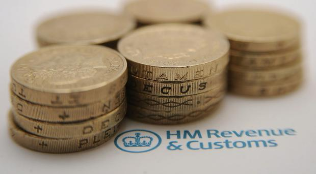 HMRC officials raided firms and seized business records