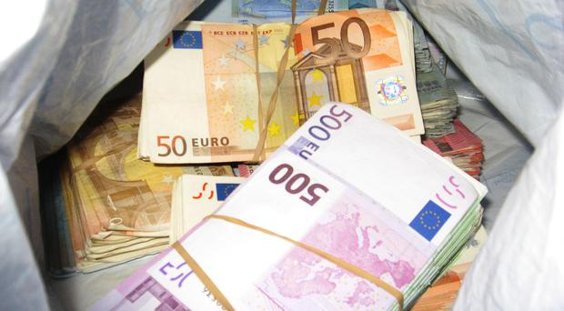 An estimated £46,000 and £30,000 in euro notes were discovered when officers from HM Revenue and Customs searched a property in the Newtownbutler area on Thursday (HM Revenue and Customs/PA)