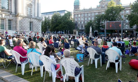 A large crowd gathered in the Belfast City Hall grounds to watch opera Tosca live on the big screen in July 2013
