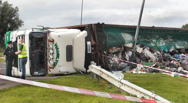 Police at the scene of the lorry crash on the roundabout outside the City of Derry Airport on Saturday afternoon