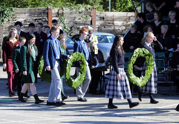 Schoolchildren carry wreaths at the annual National Famine Commemoration ceremony in Newry