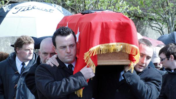 Colum Eastwood (front left) carries the coffin of former Derry republican Seamus 'Chang' Coyle