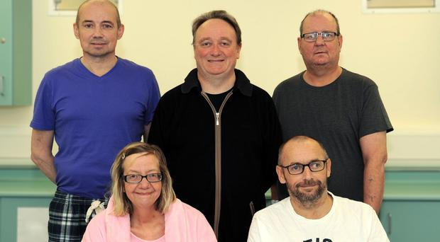 Transplant patients, back row left to right, Audrius Orinas, Aidan Murtagh and John Finnigan, and front row, Fiona Anderson and John McGinley (Belfast City Hospital/PA)