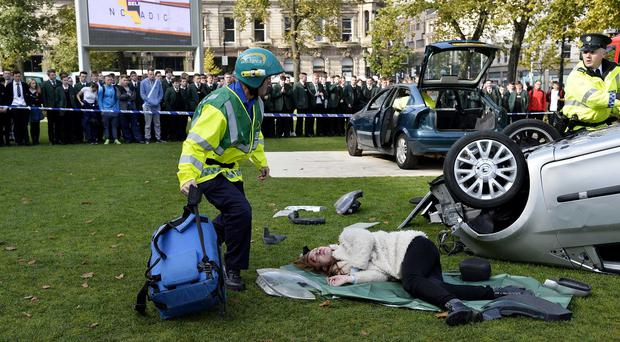 Emergency services reconstruct a road traffic collision at City Hall in Belfast as part of a road safety event (Belfast City Council/PA)