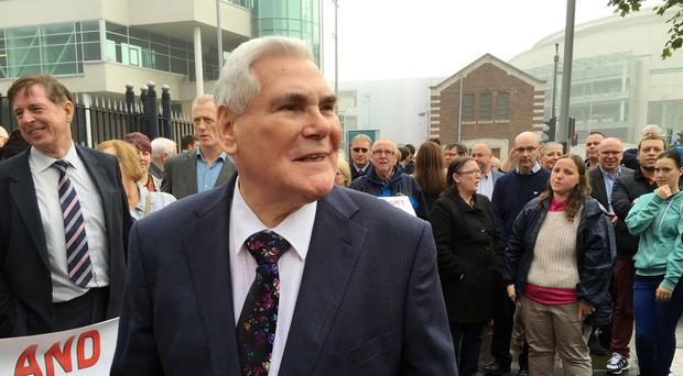 Pastor James McConnell surrounded by Christian supporters after appearing at Belfast Magistrates' Court