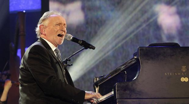Phil Coulter tells in the interview that he wanted to be a priest before deciding on a career in music