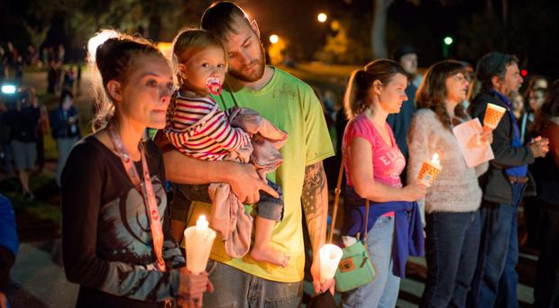 Mourners attend a candlelight vigil in Roseburg, Oregon, for the people killed and wounded in the college shooting