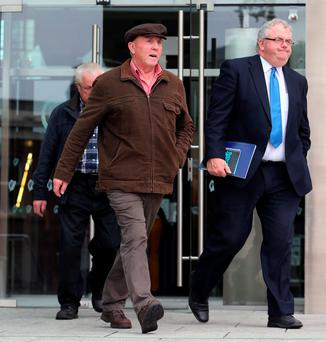 Thomas 'Slab' Murphy (left) leaves the non-jury Special Criminal Court in Dublin yesterday