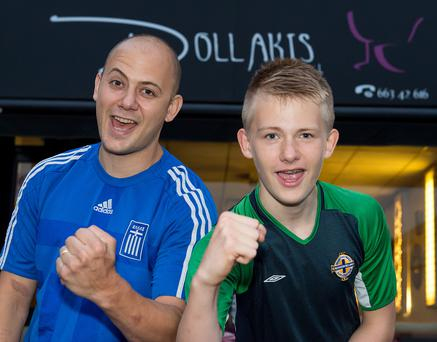 Father and son Georgios and Jack Maravelakis outside their Greek restaurant Dollakis in Enniskillen ahead of the European Championship Qualifier between Northern Ireland and Greece