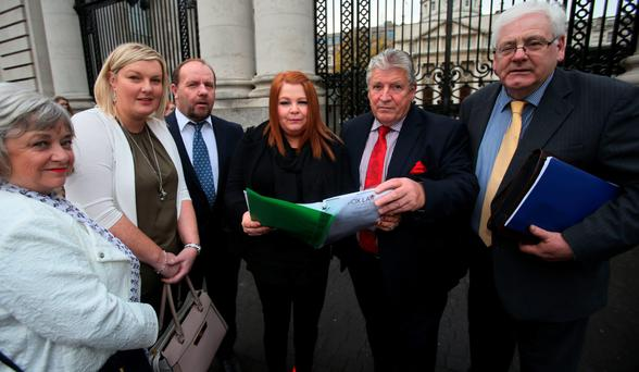 Gerty McGlinn, Amanda McCallion, Frank Devlin, Cat Wilkinson, Stanley McCombe and Michael Gallagher, representatives of families of the Omagh bomb victims, arrive at Government Buildings in Dublin to meet Taoiseach Enda Kenny for the first time