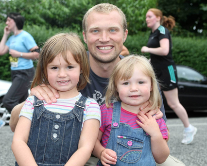 Family man: Warren Feeney has quit as Linfield boss to be closer to daughters Lucy and Darcy