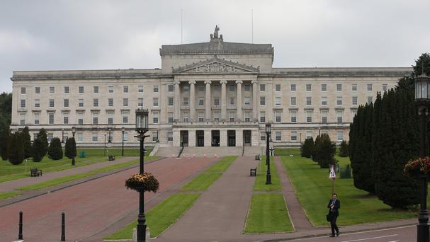 Stormont ministers are in office for one day a week as part of the introduction of an in-out policy while political talks continue