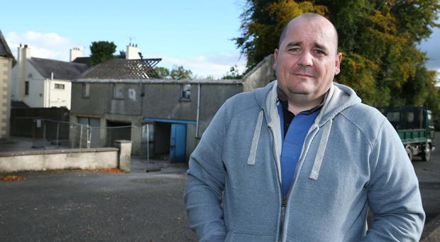 Richard O'Shea outside the former Scout hall in the grounds of St Peter and St Paul's Church, Bessbrook, which is now being knocked down after a campaign by Colin Finnegan's victims