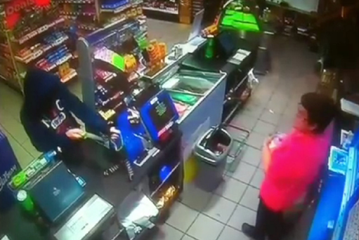 CCTV footage showing the robber fleeing after getting soaked